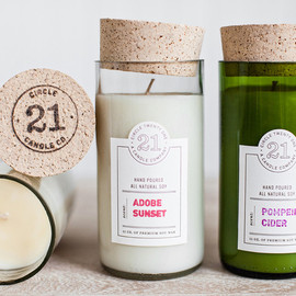 Circle 21 - Close up of Circle 21 Candles showing letterpress labels and cork toppers