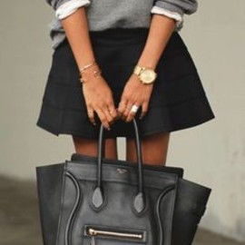 black celine bag with mini skirt + sweatshirt