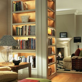 A Lovely Library. Well-lit bookshelves.