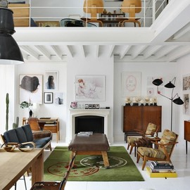 a white-washed loft is a blank canvas accented with vintage pieces and modern artwork | Design Milk