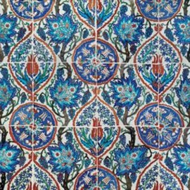AN IZNIK POTTERY TILE PANEL