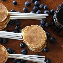 Pancakes and blueberries on sticks