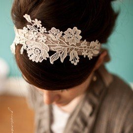 a headband, fabric stiffener spray, and little piece of lace.