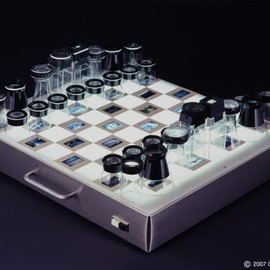 Chris Dimino - Chess set with magnifying loupes and light box
