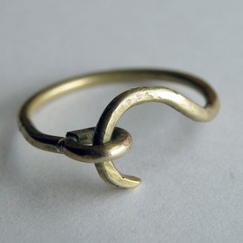 Brass hook ring. - Brass hook ring.