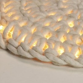 Crocheting around rope light to make an outdoor floor mat. So Cool!