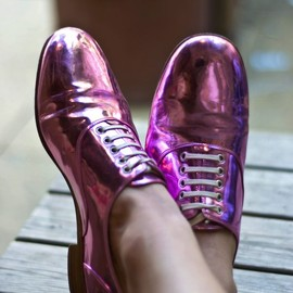 Christian Louboutin - pink metallic shoes.