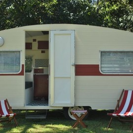 camper - Cream and red with matching sling chairs.  Vintage Caravan Magazine. (Photo Mark Waterson).