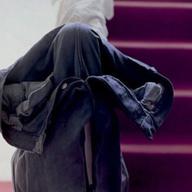 Wolfgang Tillmans - grey jeans over stair post