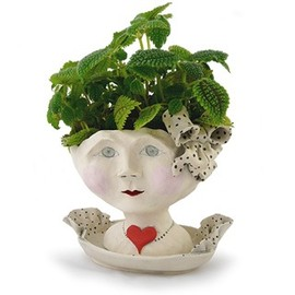 head-shaped flower planter