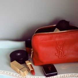 Yves Saint Laurent - red beauty bag.