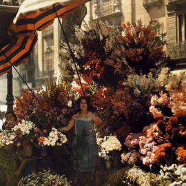 Jules Gervais-Courtellemont - A woman stands in front of her flower stand on the Rambla in Barcelona, Spain, March 1929.