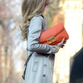 long hair. bright clutch.