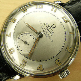 OMEGA - bumper steel early automatic Newark dial 1946
