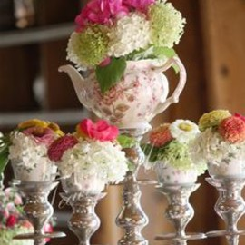 Fresh blooms in a teapot & cups