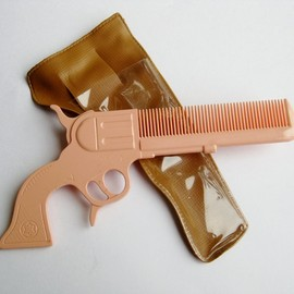 Rodeo Queen - Vintage 40s Rodeo Queen Gun Shaped Novelty Hair Comb & Holster. $32.00, via Etsy.