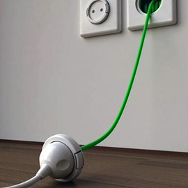 Extension cord built into the wall. What a GREAT idea.