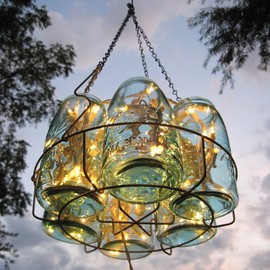 mason jar chandelier ...jars in a canning rack with string lights