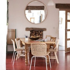 Dining room with mirrors, light wood and pale-coloured chairs