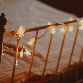 string of lights on a bedstead
