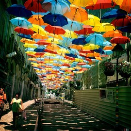 PORTUGAL - FLOATING UMBRELLA INSTALLATION IN THE STREETS OF AGUEDA