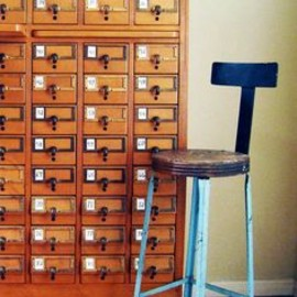 metal stool and card catalog