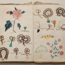 Friendship album, Margaret Williams, 1839, Album with locks of hair sewn onto the pages in loops of stylized flowers with colored drawings of flowers