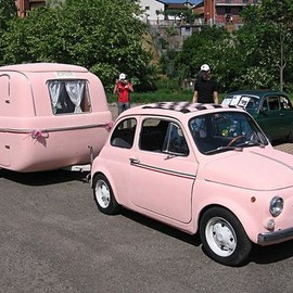 Pink Fiat 500 and camper
