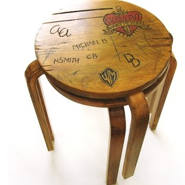 Aalto knock-off stools carved up with the desktop graffiti from Alice Cooper's 1972  - Distressed Finnish stool
