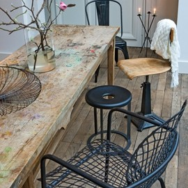 weathered table + mixed vintage chairs