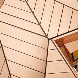 Emrys Architects - Great James Street Office extension with a faceted copper roof