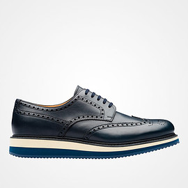 PRADA - Calf leather laced shoe  Perforated wingtip motif on the toe  Micro rubber sole with colored bands