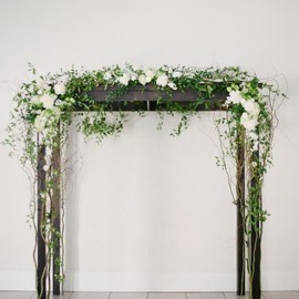 flowers - a simple ceremony arch draped