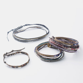 The Gunmetal Nugget Wrap Bracelet with Sterling Silver Skulls on Red Brown Leather by jewelry designer Chan Luu
