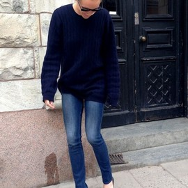 My Version: Dark Blue V-Neck Sweater, Medium Wash or Light Wash Skinny Jeans, Black Braided Flats.