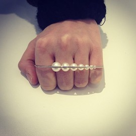 MELANIE - Four fingers ring in white gold & white pearls by MELANIE GEORGACOPOULOS. #colette #colettestore #melaniegeorgacopoulos #ring