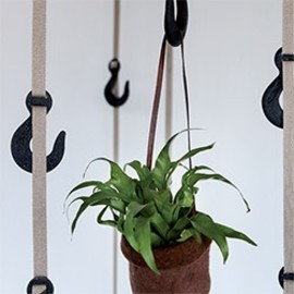 """Tapegear Grapple hanging system - """"Inspired by old, industrial crane hooks, Grapple is a unique hanging system for coats, hats, bags and anything else deemed fit for them."""""""