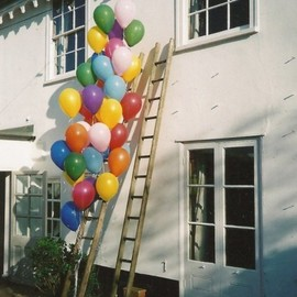 two ladders with so many colorful balloons!! :)