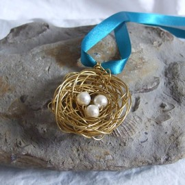 Luulla - Brass Nest Pendant: A cute birds nest pendant made from wire with three white pearl bead eggs.