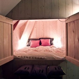 Bed in a wall. So cute and comfortable.