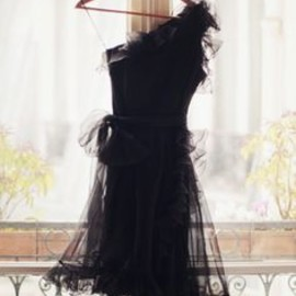Frilly little black dress.