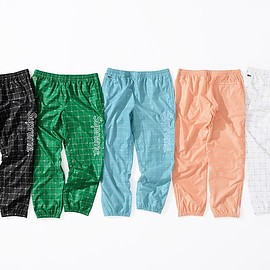 Supreme, LACOSTE - Nylon Track Pant with 3M Reflective pattern.