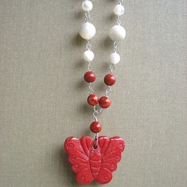 Luulla - Coral butterfly pendant.