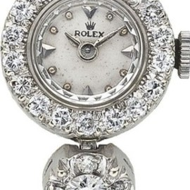ROLEX - Diamond, White Gold Integral Bracelet Wristwatch, circa 1950.