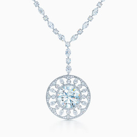 Tiffany & Co. - From the Legacy Gemstones collection, the Tiffany Noble necklace is designed to maximize the radiance of the internally flawless, 18.44-carat center diamond.