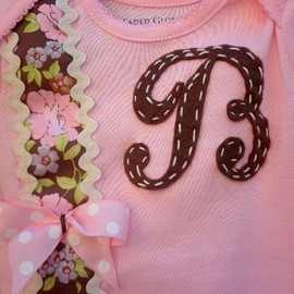 Luulla - Baby girl boysuit accented with initial and beautiful ribbon. Newborn to toddler sizes.