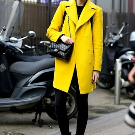 CHANEL - Off-duty in a bright yellow hopper and Chanel bag