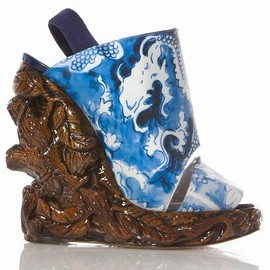 Nicholas Kirkwood - A collaboration from designers Rodarte & Nicholas Kirkwood yields a pair of unique mixed-media, sculptor-made wedges. The glossy carved 6