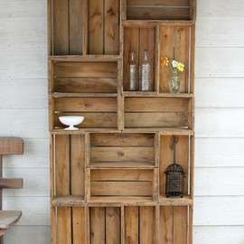 A bookshelf made out of antique apple crates