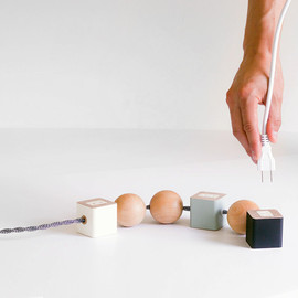 okum - oon by okum reconstructs the common power cord